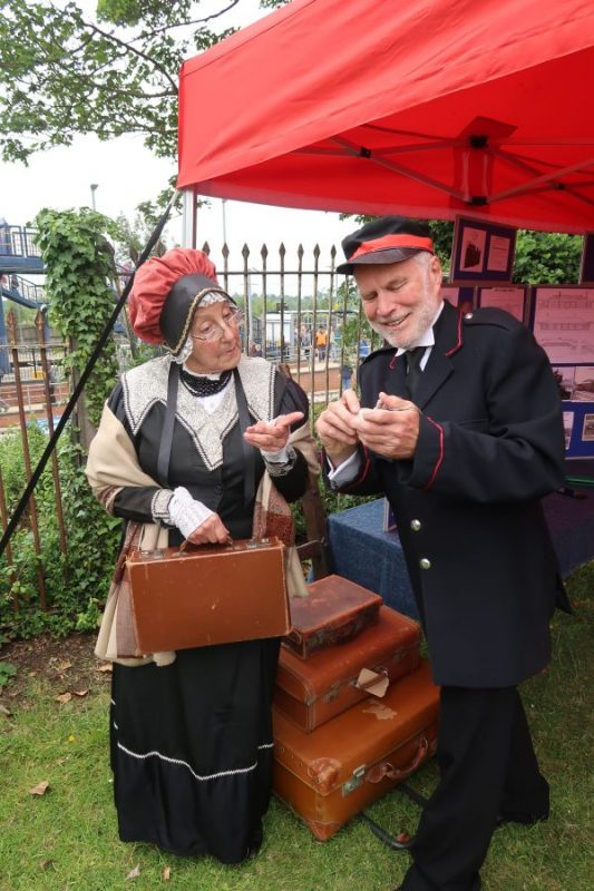 Polly Mountain and Nicholas Lawrence in Victorian costume at Radley History Club's stall to celebrate the 175th Anniversary of the Didcot-Oxford railway line on 15 June 2019