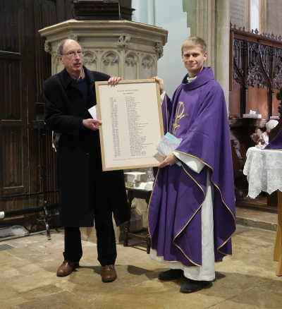 Presentation by Richard Dudding of Radley History Club of a new list of Radley's vicars to Rob Genny, vicar of Radley