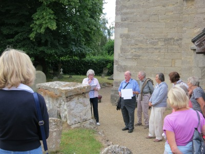 Brian and Rita Ford lead the tour of the churchyard, pausing by the Cavalier's Tomb
