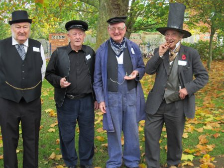 Visitors were greeted by a team of Club members dressed for the part - from left to right: Eric Blanks (stationmaster), Brian Ford (porter), Tony Rogerson (engine driver) and Denis Standen (Isambard Kingdom Brunel).