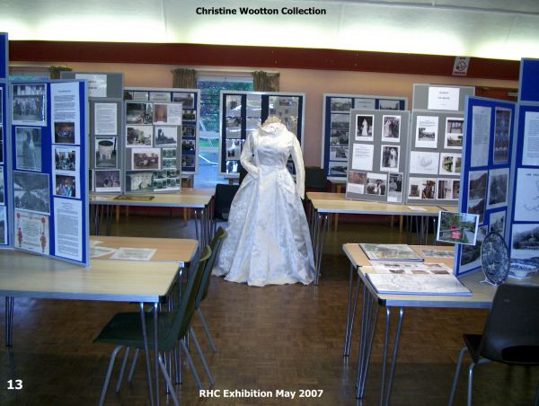 Photograph from the exhibition with the wedding dress in the centre