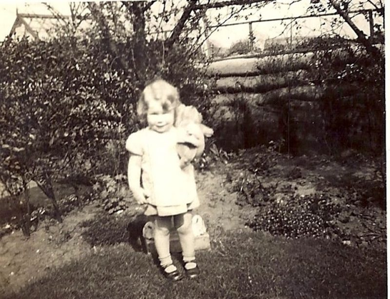 Christine pictured in the family's back garden with the air raid shelter in the background
