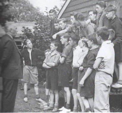 Bigwood Camp, Radley, in 1941: David is standing alone on the left as Sir Ralph Glynn, MP for Abingdon, addresses the boys. The photo is taken from David's autobiography, Hostilities Only.
