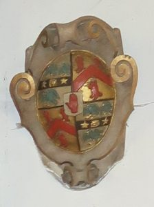 The village emblem is a modern representation of a 17th century shield on the wall in the chancel of Radley Church